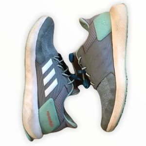 Mint and gray slide on Adidas sneakers